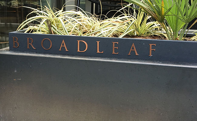 restaurant planters with incorporated signage