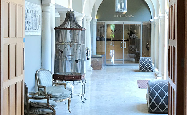 hotel spa entrance with large bird cage in the Alexander House Hotel