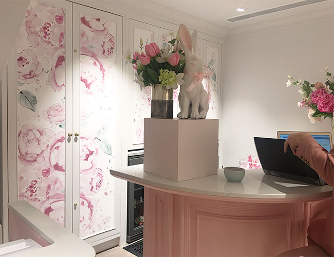 champagne parlour reception area of Peggy Porchen shop, featuring peony wallpaper clad doors.