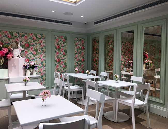 By entering this Peggy Porchen cake shop we were transported to a world of escapism. The interior is like walking into a rose garden at Barbie's dreamhouse