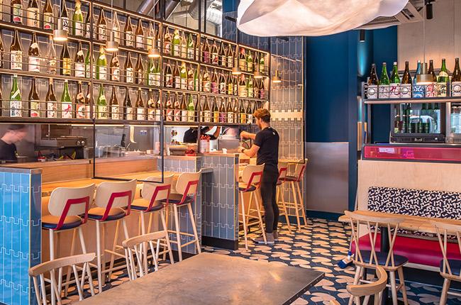 sake bottle display at modern ramen restaurant in London