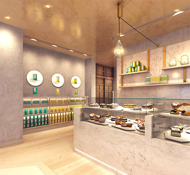 Bakery and café interior style that not only promotes in-store baked goods but also offers a relaxed retail environment that displays teas and luxury gift packs.