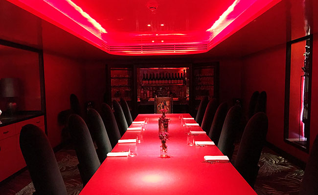 red interior of private dining room at Serge et le Phoque restaurant in London