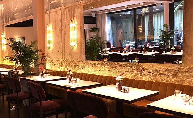 Michelin star restaurant with exposed bricks and shattered concrete walls