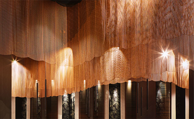 woven metal curtain in a sophisticated Asian restaurant design