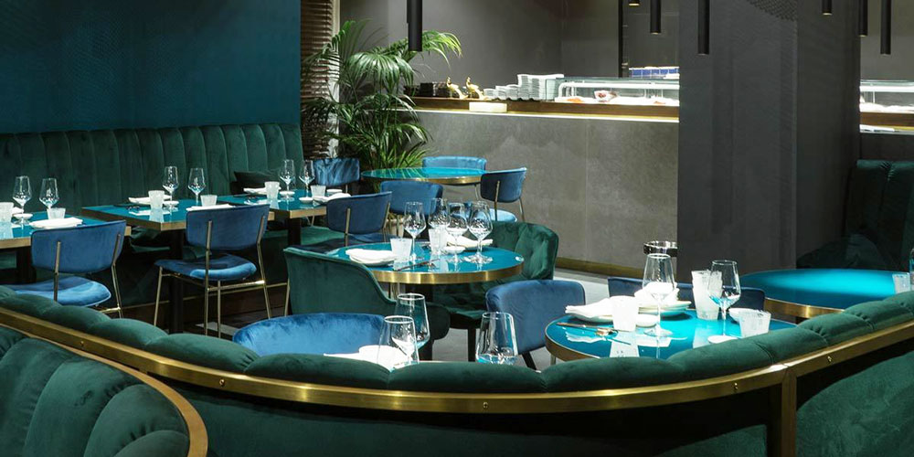 Nishiki restaurant designers opted for blue and green velvet chairs and sofas surround brass edged lacquer top tables.
