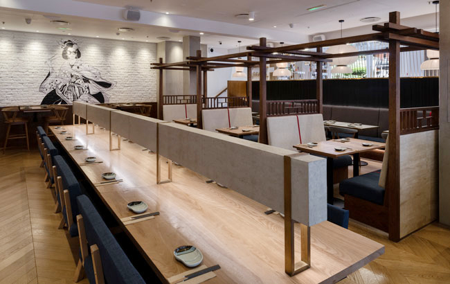 Several of the fixtures and furnishings have been crafted by our designers specifically for the restaurant, including wooden seating pods, bespoke concrete light running down the centre of the dating  table.