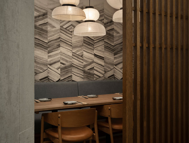 private dining room in Japanese restaurant featuring wall panels by Arte, paper lanterns and oak screen. tables and chairs were specially chosen by our restaurant designers.