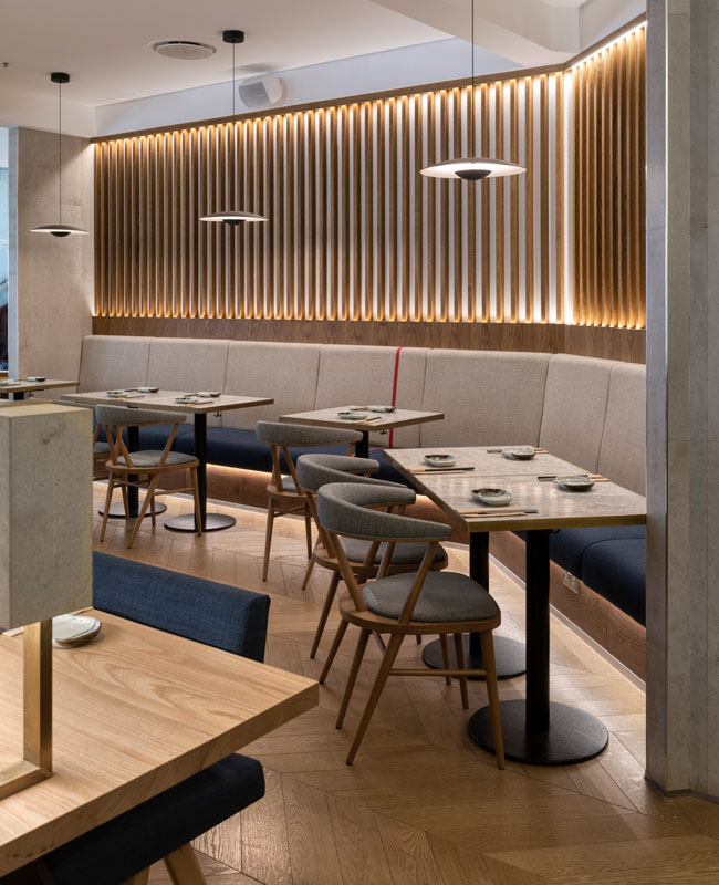 JApanese restaurant Osaka with bespoke fixed seating featuring screen and Ginger pendants