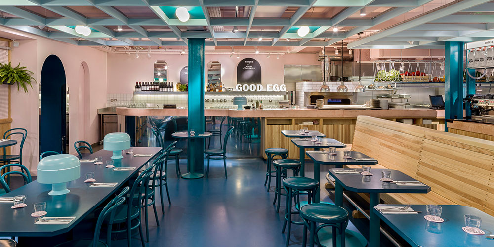 The Good Egg designers created a trendy space by combining pink ceiling and blue resin floor.